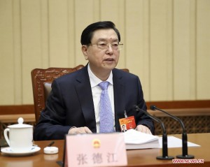 Zhang Dejiang, executive chairperson of the presidium of the third session of China's 12th National People's Congress (NPC), presides over the third meeting of the presidium at the Great Hall of the People in Beijing, capital of China, March 14, 2015. [Photo/Xinhua]