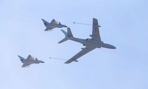 China stages largest air force show for V-Day celebration. In the photo is the refueling and receiver echelon. [Xinhua]