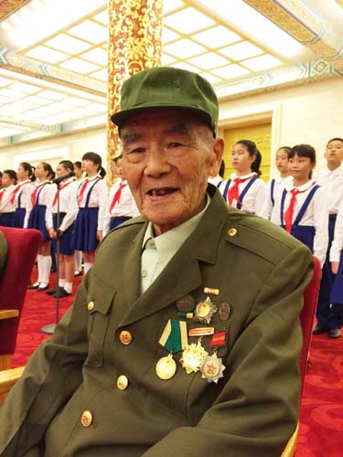 Shi Baodong, 90, from East China's Jiangsu province, fought in the counter-Japanese war for five years and took part in the Gaoyou Campaign, China's last battle against Japanese invaders. [Photo by Zhao Yinan/China Daily]