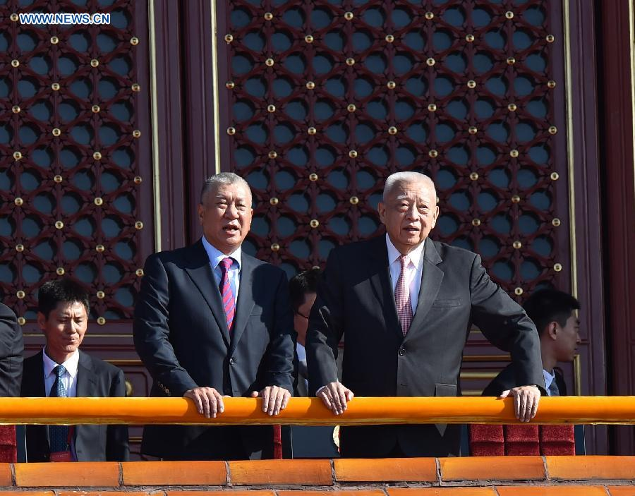 Tung Chee-hwa (R) and Edmund Ho Hau Wah, vice chairmen of the National Committee of the Chinese People's Political Consultative Conference, are seen on the Tian'anmen Rostrum.