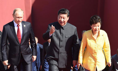 Xi arrives at Tian'anmen Rostrum with world leaders, representatives.