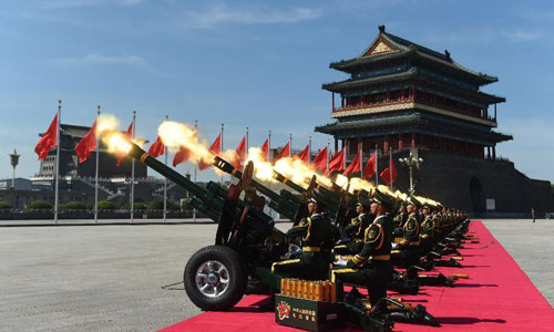 A gun salute is held during the commemoration activities to mark the 70th anniversary of the victory of the Chinese People's War of Resistance Against Japanese Aggression and the World Anti-Fascist War, in Beijing, capital of China, Sept. 3, 2015. [Xinhua]