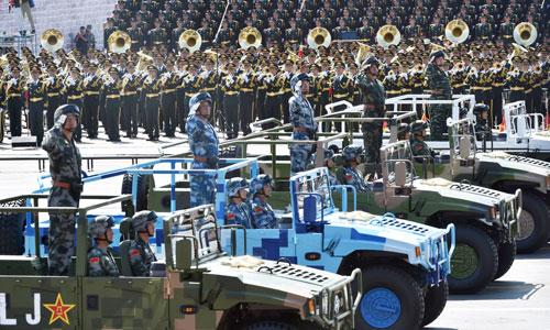 Lieutenant Generals Bai Jianjun, Tian Zhong, Chen Dong, Wu Guohua, Pan Changjie (from left to right) lead the formations of weaponry to parade through the Tian'anmen Square.