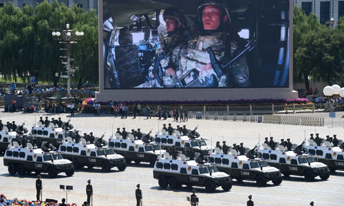 In the photo is the formation of anti-terrorist assault vehicles. [Photo/Xinhua]