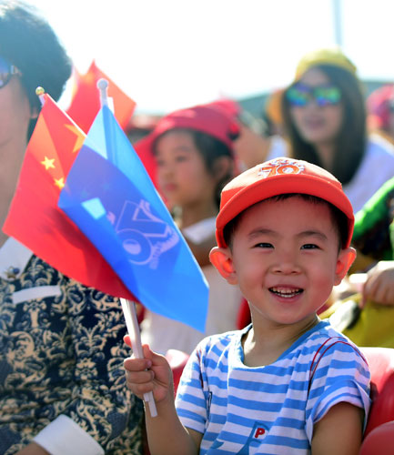 A little boy is seen among the audience watching the military parade on Sept. 3 on the Tian'anmen Square in Beijing, capital of China. [Photo/Xinhua]
