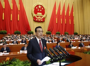 Chinese Premier Li Keqiang delivers the government work report to nearly 3,000 legislators in the Great Hall of the People on March 5, 2016.