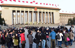 Journalists wait to enter the Great Hall of the People before the fourth session of China's 12th National People's Congress (NPC) in Beijing, capital of China, March 5, 2016.