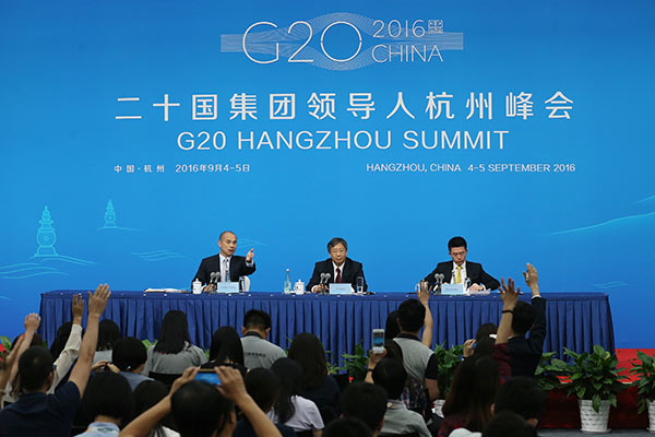 Yi Gang, vice-governor of People's Bank of China, answers questions at a press conference on Sept. 2, 2016, prior to the G20 Leaders Summit to be held in Hangzhou, Zhejiang Province.