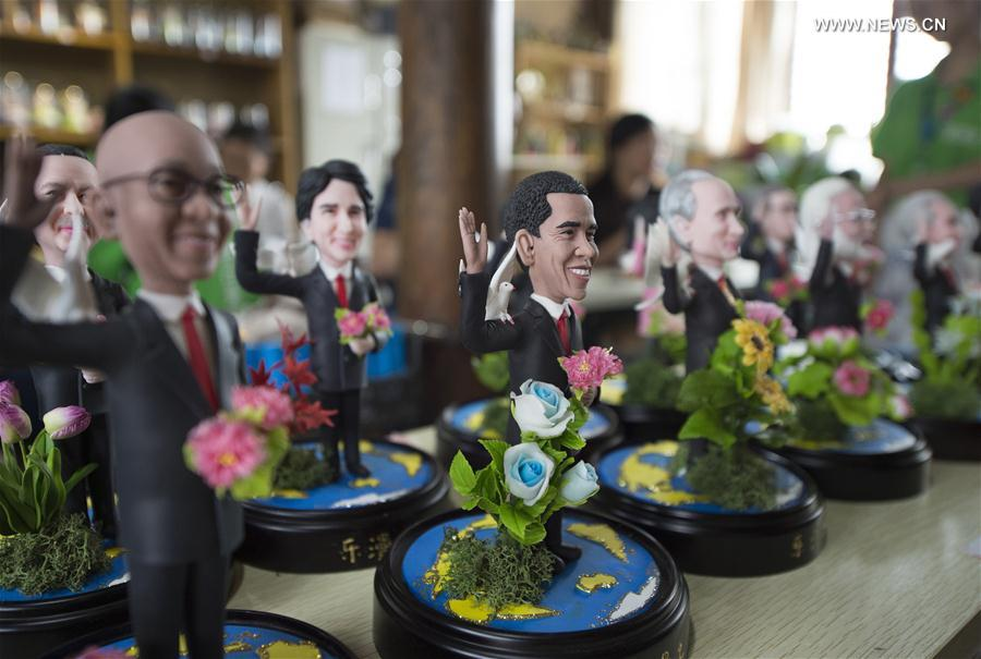 "Clay figures featuring the leaders to attend the upcoming G20 Summit are seen in Hangzhou, capital of east China's Zhejiang Province, Sept. 1, 2016. Made by artist Wu Xiaoli with the name ""Dream of World Peace"", the clay figures were displayed at Hangzhou's Qiaoxi historic block."